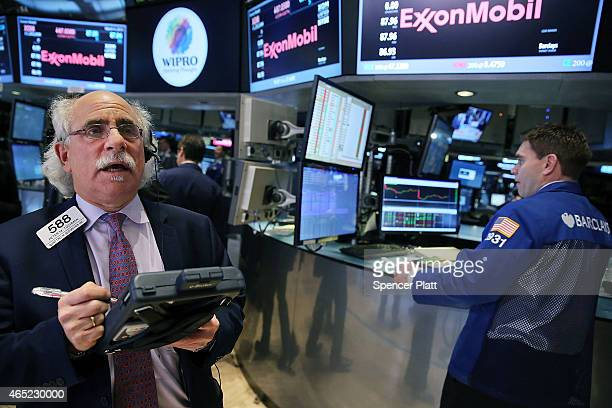 Traders work on the floor of the New York Stock Exchange before the Closing Bell on March 4 2015 in New York City The Dow Jones industrial avergae...