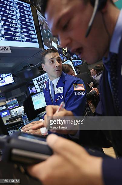 Traders work on the floor of the New York Stock Exchange during morning trading on May 20 2013 in New York City Stocks are slightly up in morning...