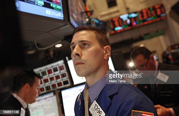 Traders work on the floor of the New York Stock Exchange during morning trading on June 3 2013 in New York City Stocks were mixed in morning trading...