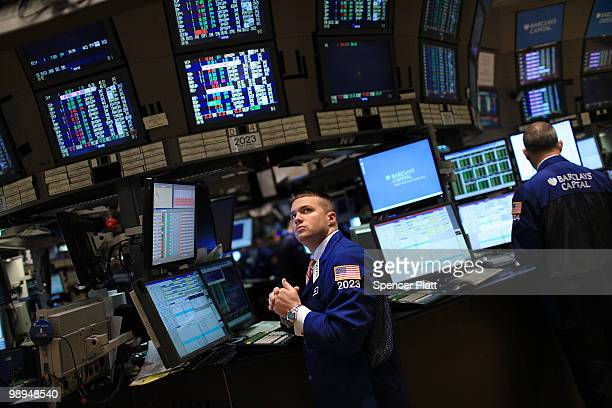Traders work on the floor of the New York Stock Exchange during morning trading on May 10 2010 in New York City Following an agreement by the...