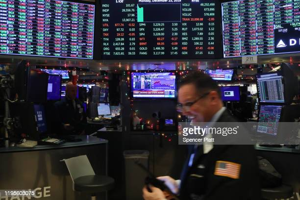 Traders work on the floor of the New York Stock Exchange during the beginning of the Christmas holiday week on December 23, 2019 in New York City....