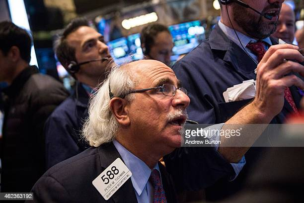 Traders work on the floor of the New York Stock Exchange during the afternoon of January 27 2015 in New York City The Dow Jones Industrial Average...
