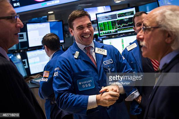 Traders work on the floor of the New York Stock Exchange during the afternoon of February 3 2015 in New York City The Dow Jones Industrial Average...