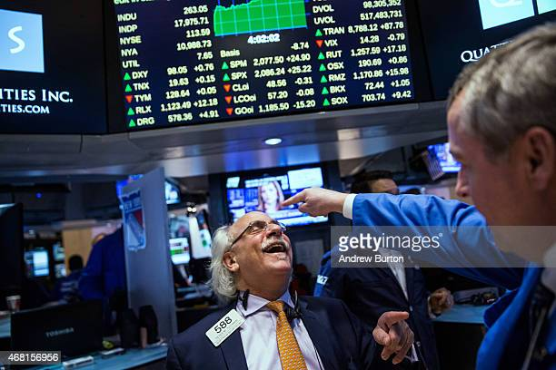 Traders work on the floor of the New York Stock Exchange during the afternoon of March 30 2015 in New York City The Dow Jones Industrial Average rose...