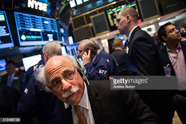 Traders work on the floor of the New York Stock Exchange during the morning of May 15 2015 in New York City The Dow Jones Industrial Average was...
