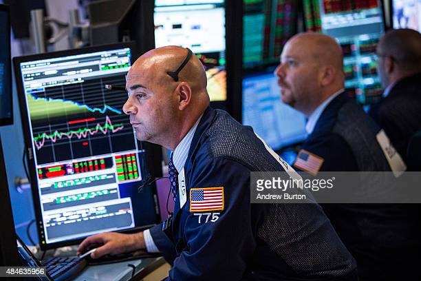 Traders work on the floor of the New York Stock Exchange during the afternoon of August 20 2015 in New York City The Dow Jones continued its plunge...