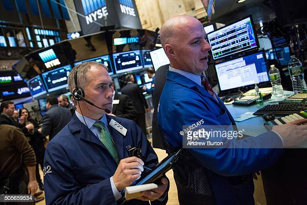 Traders work on the floor of the New York Stock Exchange during the morning of January 19 2016 in New York City The Dow Jones Industrial Average rose...