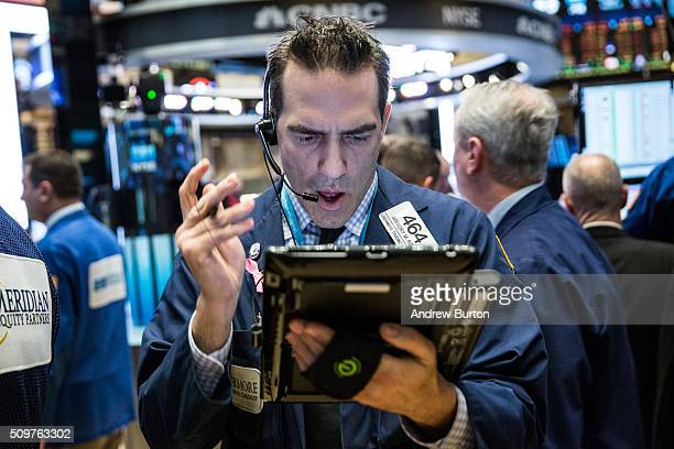 Traders work on the floor of the New York Stock Exchange during the morning of February 12 2016 in New York City The market rose more than 100 points...