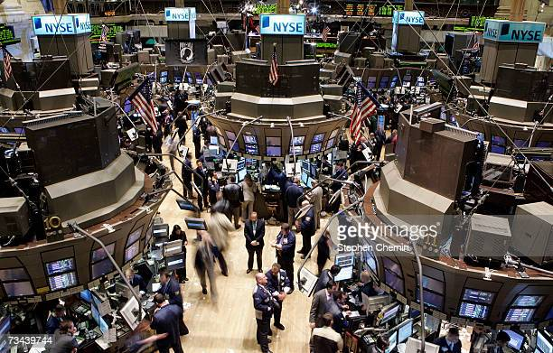 Traders work on the floor of the New York Stock Exchange February 27, 2007 in New York City. The Dow Jones dropped in the biggest one day slide in...