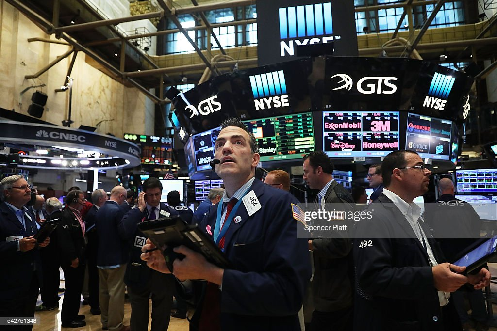 Traders work on the floor of the New York Stock Exchange (NYSE) following news that the United Kingdom has voted to leave the European Union on June 24, 2016 in New York City. The Dow Jones industrial average quickly fell nealy 500 points on the news with markets around the globe plunging.