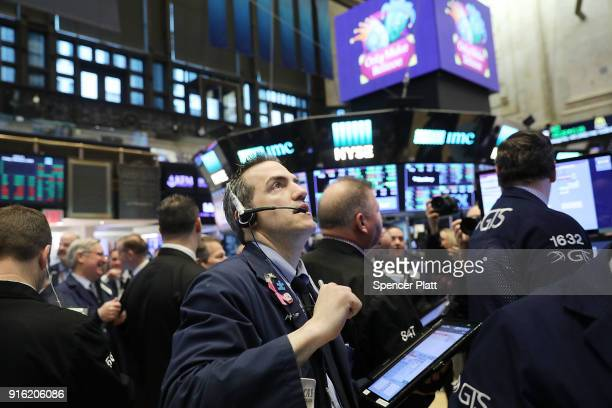 Traders work on the floor of the New York Stock Exchange Friday morning on February 9 2018 in New York City Following a drop in the Dow Jones...