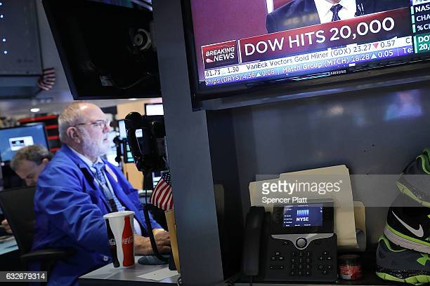 Traders work on the floor of the New York Stock Exchange in late morning trading after the Dow Jones industrial average crossed the 20000 mark for...