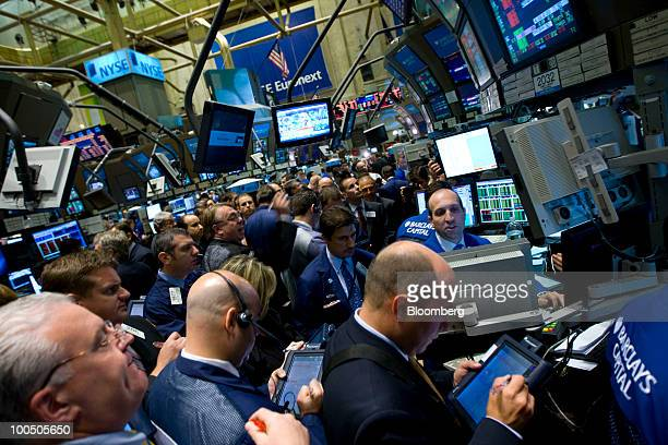 Traders work on the floor of the New York Stock Exchange in New York, U.S., on Tuesday, May 25, 2010. Stocks plunged from Tokyo to London and New...