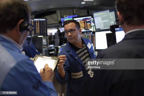 A trader works on the floor of the New York Stock Exchange in New York US on Friday Aug 17 2018 US stocks rose in light summer trading Friday...