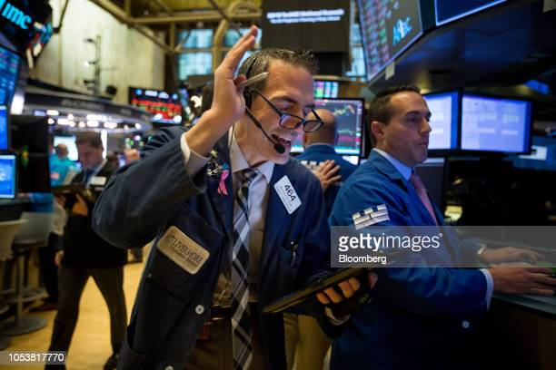 Traders work on the floor of the New York Stock Exchange in New York US on Friday Oct 26 2018 The slide in US stocks picked up speed with the SP 500...