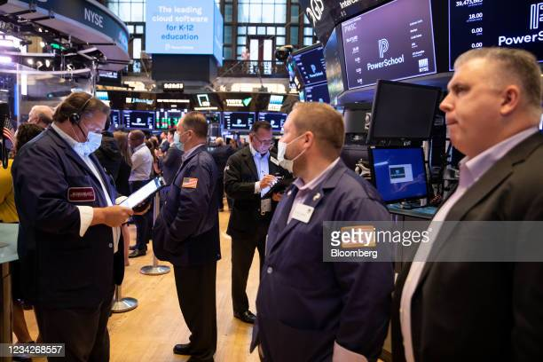 Traders work on the floor of the New York Stock Exchange in New York, U.S., on Wednesday, July 28, 2021. U.S. Futures drifted and stocks were mixed...