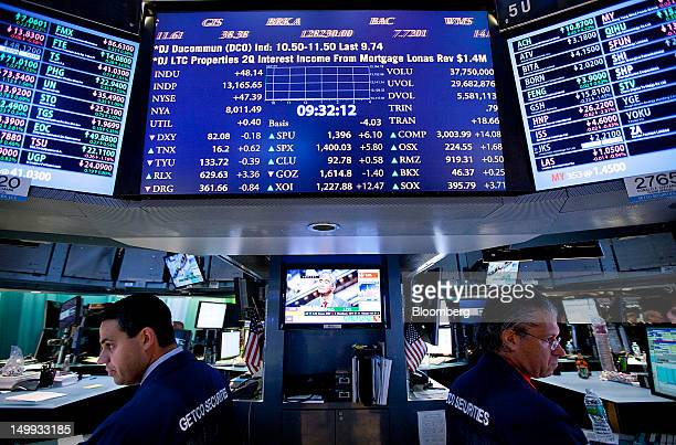 Traders work on the floor of the New York Stock Exchange in New York US on Tuesday Aug 7 2012 US stocks advanced sending the Standard Poor's 500...