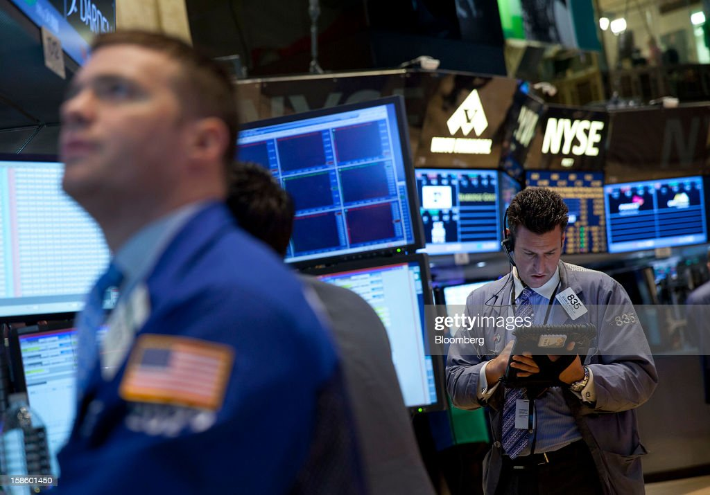Traders work on the floor of the New York Stock Exchange (NYSE) in New York, U.S., on Thursday, Dec. 20, 2012. InterContinentalExchange Inc. (ICE), the 12-year-old energy and commodity futures bourse, agreed to acquire NYSE Euronext for cash and stock worth $8.2 billion, moving to take control of the world's biggest equities market. Photographer: Jin Lee/Bloomberg via Getty Images