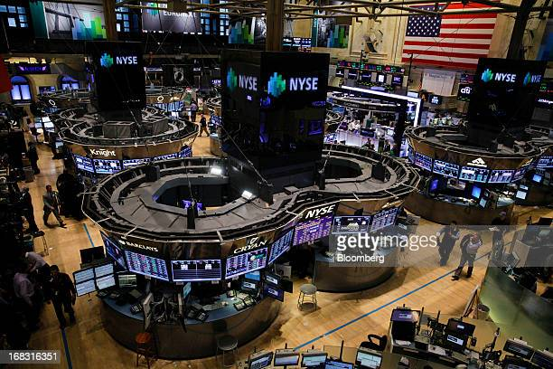 Traders work on the floor of the New York Stock Exchange in New York US on Wednesday May 8 2013 US stocks rose after the Dow Jones Industrial Average...