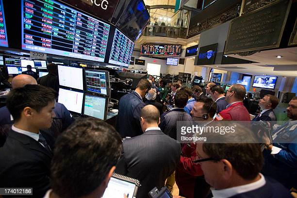 Traders work on the floor of the New York Stock Exchange in New York US on Friday July 19 2013 US stocks fell after benchmark equities gauges rose to...