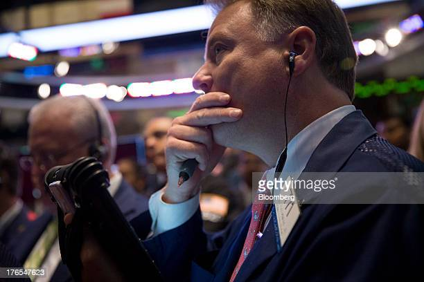 Traders work on the floor of the New York Stock Exchange in New York US on Thursday Aug 15 2013 US stocks declined sending the Standard Poor's 500...