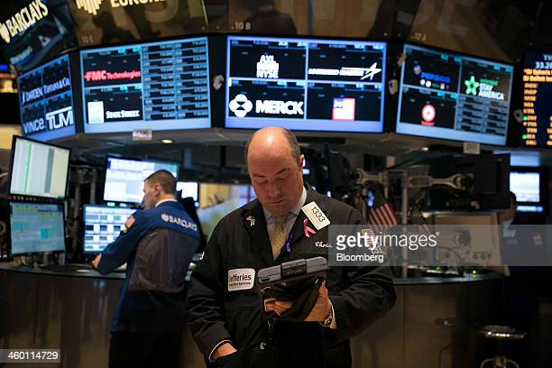 Traders work on the floor of the New York Stock Exchange in New York US on Thursday Jan 2 2014 US stocks declined following the best year since 1997...
