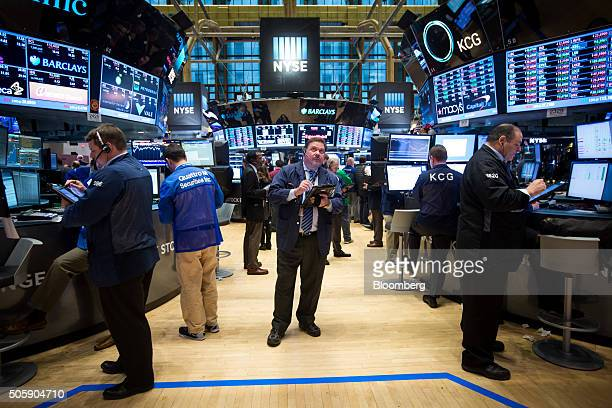 Traders work on the floor of the New York Stock Exchange in New York, U.S., on Wednesday, Jan. 20, 2016. U.S. Stocks surged back to pare the biggest...