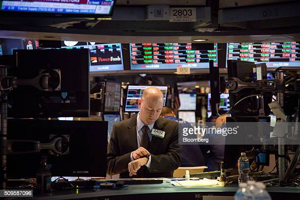 Traders work on the floor of the New York Stock Exchange in New York, U.S., on Thursday, Feb. 11, 2016. Global equities tumbled toward a bear market,...