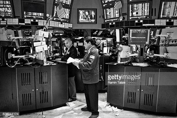 Traders work on the floor of the New York Stock Exchange in New York, on Friday, October 29, 2010.