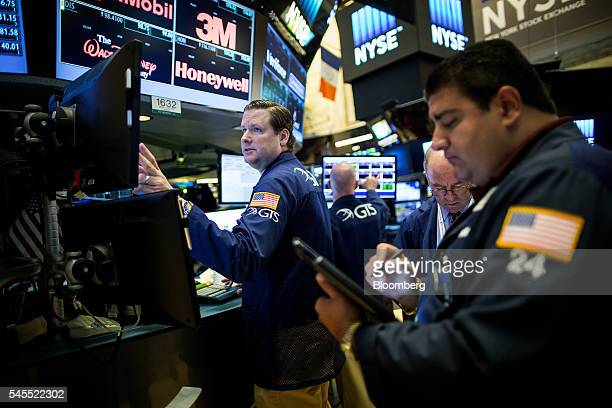 Traders work on the floor of the New York Stock Exchange in New York US on Friday July 8 2016 US stocks rallied to erase losses sparked by Britain's...