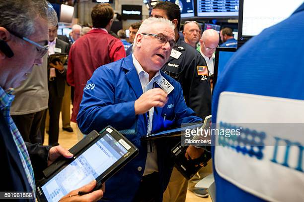 Traders work on the floor of the New York Stock Exchange in New York US on Friday Aug 19 2016 US stocks slipped for the first time in three days with...