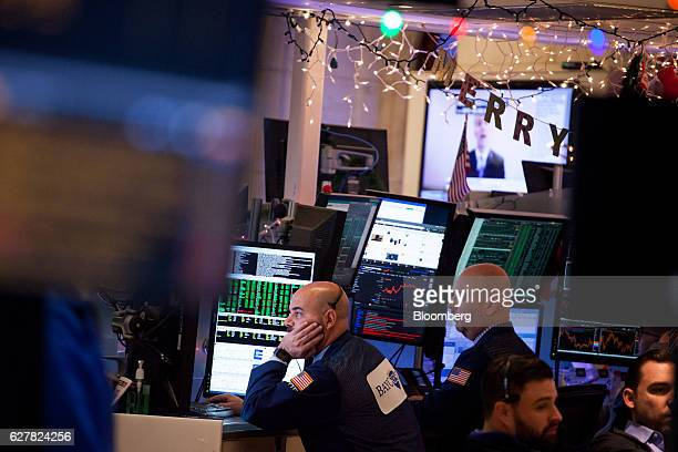 Traders work on the floor of the New York Stock Exchange in New York US on Monday Dec 5 2016 US stocks climbed reversing a brief dip in early trading...