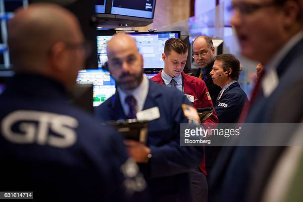 Traders work on the floor of the New York Stock Exchange in New York US on Friday Jan 13 2017 US stocks rose toward a record Treasuries fell and the...