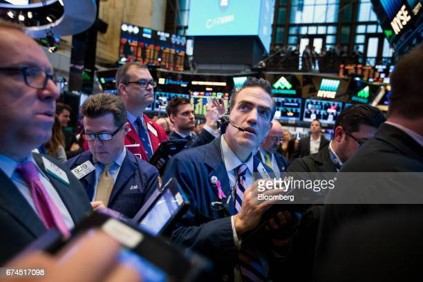 Traders work on the floor of the New York Stock Exchange in New York US on Friday April 28 2017 US stocks remained near record highs Treasuries...