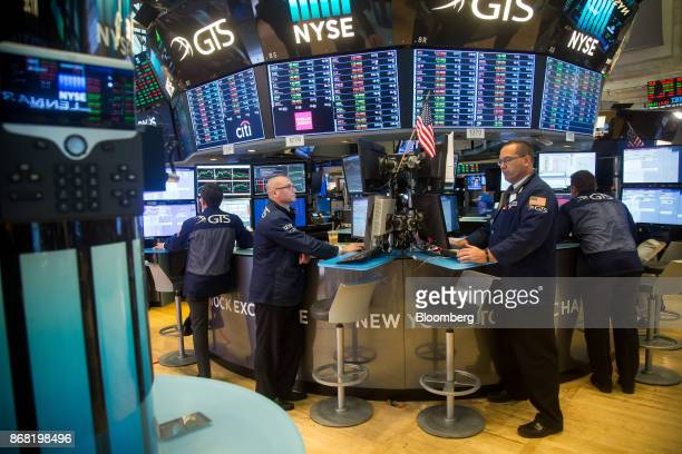 Traders work on the floor of the New York Stock Exchange in New York US on Monday Oct 30 2017 US stocks fell the dollar slipped and Treasuries...