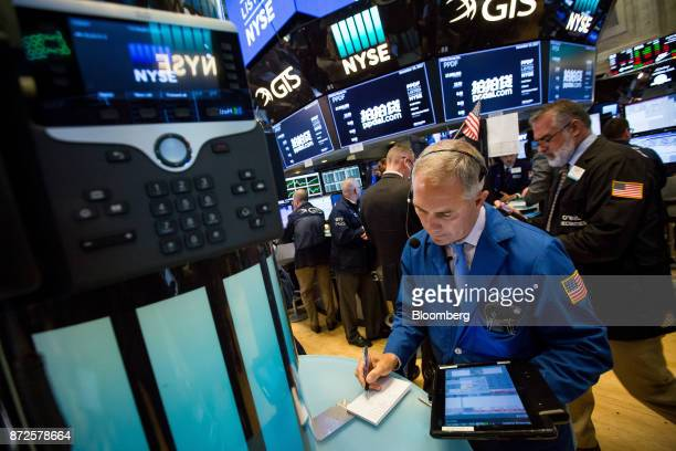Traders work on the floor of the New York Stock Exchange in New York US on Friday Nov 10 2017 Treasuries fell for a third day and US stocks limped to...
