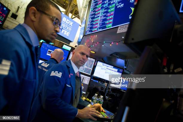 Traders work on the floor of the New York Stock Exchange in New York US on Monday Jan 8 2018 US stocks were mixed with the SP 500 Index on track for...
