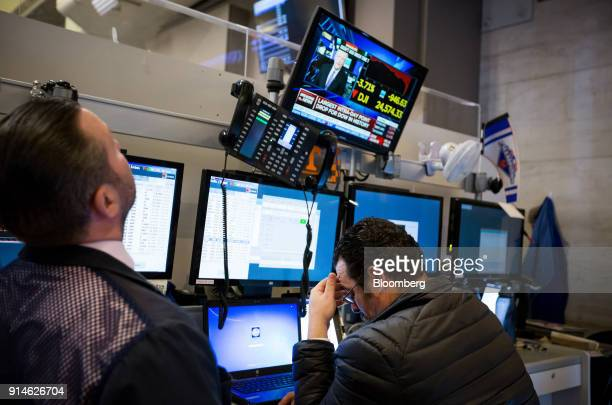 Traders work on the floor of the New York Stock Exchange in New York US on Monday Feb 5 2018 US stocks plunged sending the Dow Jones Industrial...