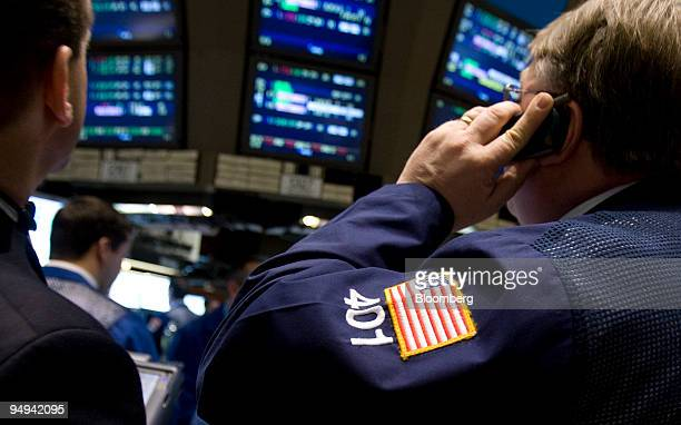 Traders work on the floor of the New York Stock Exchange in New York US on Wednesday Jan 28 2009 US stocks rose extending a global rally as President...