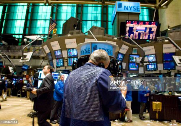 Traders work on the floor of the New York Stock Exchange in New York US on Thursday July 2 2009 US stocks fell sending the Standard Poor's 500 Index...