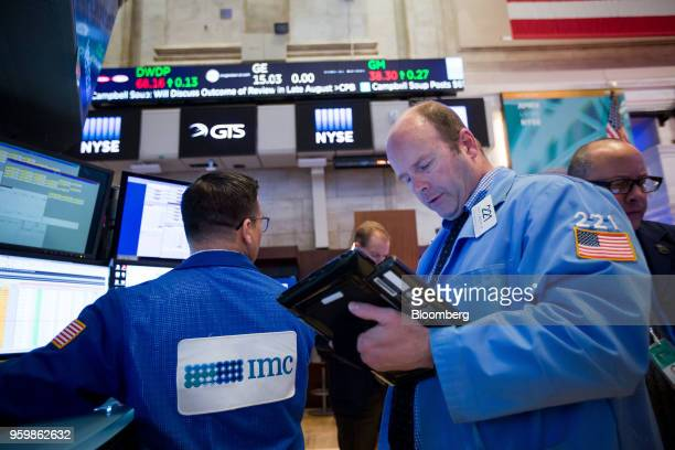 Traders work on the floor of the New York Stock Exchange in New York US on Friday May 18 2018 US stocks fluctuated the dollar rose and Treasury...