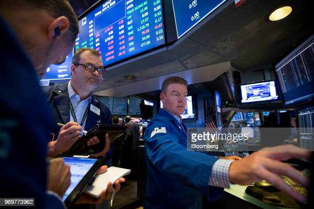 Traders work on the floor of the New York Stock Exchange in New York, U.S., on Friday, June 8, 2018. Most U.S.Equitiesdrifted lower as global...