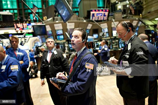 Traders work on the floor of the New York Stock Exchange in New York US on Thursday May 6 2010 The Dow Jones Industrial Average had its biggest...