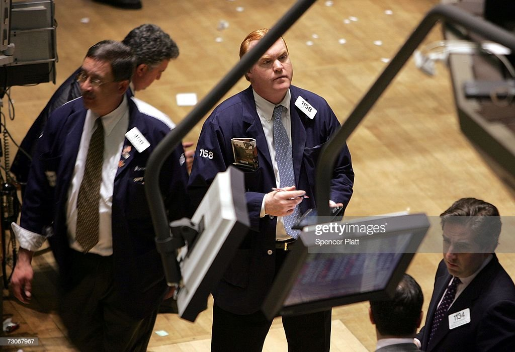 Traders work on the floor of the New York Stock Exchange (NYSE) in the financial district January 22, 2007 in New York City. In a study commissioned by New York City Mayor Michael Bloomberg and U.S. Sen. Charles Schumer (D-NY), it was determined that New York could lose its place as the financial capital of the world in as little as 10 years.