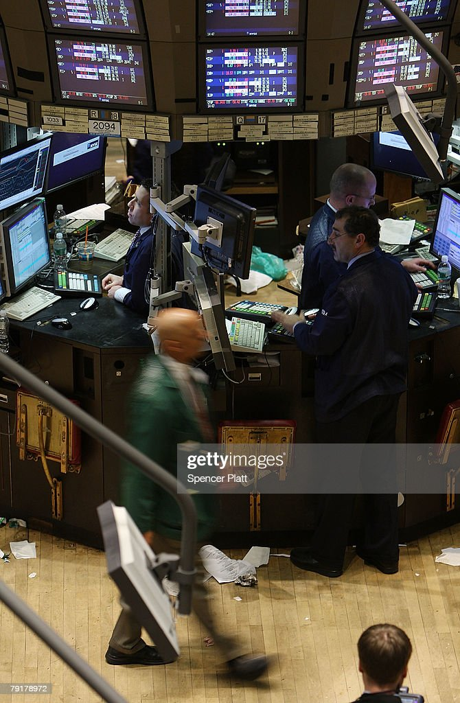 Traders work on the floor of the New York Stock Exchange January 23, 2008 in New York City. The Dow briefly hit positive territory Wednesday, after having fallen more than 300 points earlier in the session. Following a sharp fall in international markets Monday, the Federal Reserve lowered its lending rate by three quarters of a percentage point to 3.50% Tuesday.