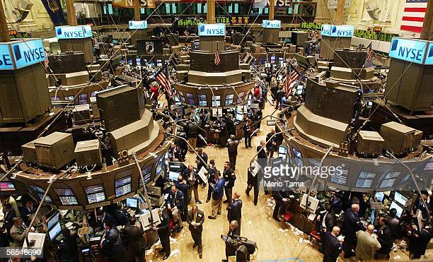 Traders work on the floor of the New York Stock Exchange January 9, 2006 in New York City. The Dow Jones industrial average passed the 11,000 mark...