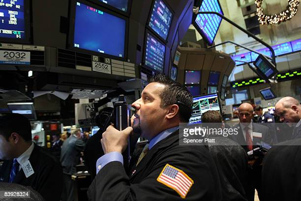 Traders work on the floor of the New York Stock Exchange moments after the closing bell December 5 2008 in New York City Despite a new monthly jobs...