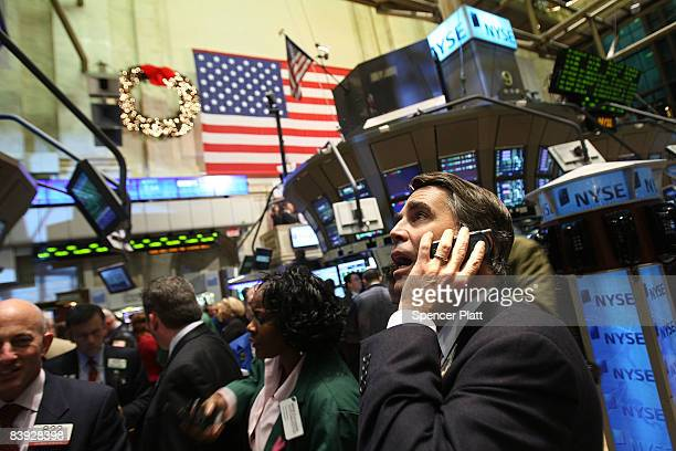 Traders work on the floor of the New York Stock Exchange moments before the closing bell December 5 2008 in New York City Despite a new monthly jobs...