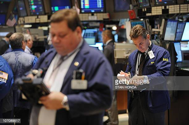 Traders work on the floor of the New York Stock Exchange November 23, 2010 after the opening bell. US stocks fell Tuesday as traders fretted over a...