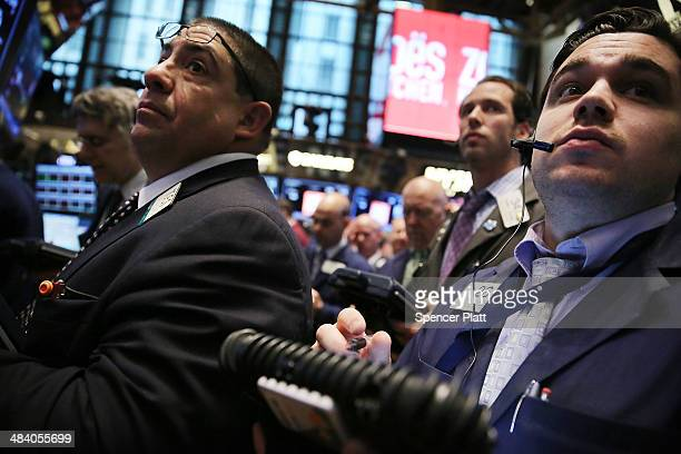 Traders work on the floor of the New York Stock Exchange on April 11 2014 in New York City In early morning trading the Dow was down over 70 points...